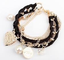 Armband med kristaller, pärlor, medaljonger och kedjor i olika utföranden -Svart