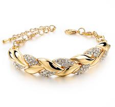 """Armband """"Braided leaf"""" med Austrian Crystals och i 18 K Guldplätering"""