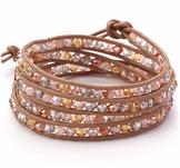 Armband med kristaller, metalldetaljer och lädersnörning