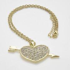 Halsband med skinande stenar och i pläterat guld