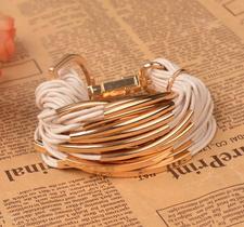 Armband i flera lager med rep och Guldfärgad metall -finns i Beige och Svart