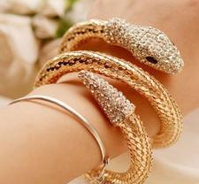 """Armband """"Snake"""" med kristaller och Guld- respektive Silverplätering"""
